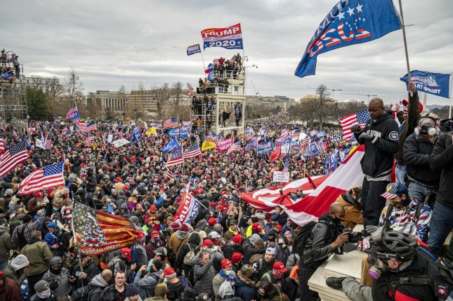 Pro-Trump rioters breach the security perimeter and penetrate the U.S. Capitol on January 6 to protest against the Electoral College vote count that would certify Joe Biden as the winner. File Photo by Ken Cedeno/UPI