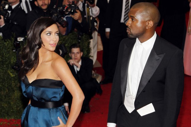 Kim Kardashian and Kanye West arrive on the red carpet at the Costume Institute Benefit celebrating the opening of Charles James: Beyond Fashion and the new Anna Wintour Costume Center at the Metropolitan Museum of Art in New York City on May 5, 2014. UPI/John Angelillo