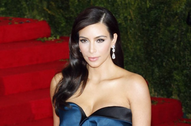 Kim Kardashian arrives on the red carpet at the Costume Institute Benefit celebrating the opening of Charles James: Beyond Fashion and the new Anna Wintour Costume Center at the Metropolitan Museum of Art in New York City on May 5, 2014. UPI/John Angelillo