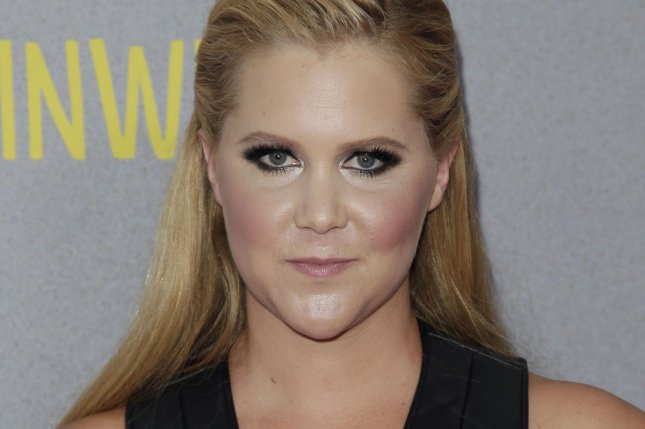 Amy Schumer arrives on the red carpet at the New York Premiere of 'Trainwreck' at Alice Tully Hall in New York City on July 14, 2015. Schumer partnered with her second cousin, Sen. Chuck Schumer (D-NY) to advocate for tighter gun laws on Capitol Hill this week. Photo by John Angelillo/UPI