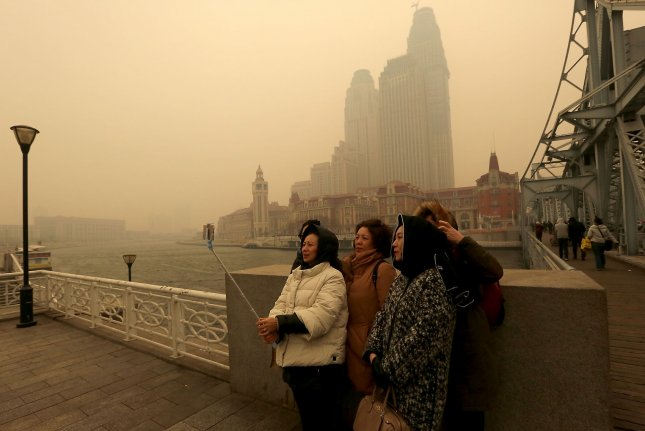 Environmental advocacy group Greenpeace says it's actually China, where smog chokes the capital city, that's taking the edge in the race for a low-carbon economy. Photo by Stephen Shaver/UPI