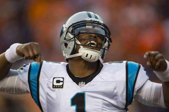 Carolina Panthers quarterback Cam Newton celebrates throwing a 14-yard touchdown pass against the Denver Broncos in the first quarter at the NFL's season opener and Super Bowl 50 rematch at Sports Authority Field at Mile High in Denver on September 8, 2016. File photo by Gary C. Caskey/UPI