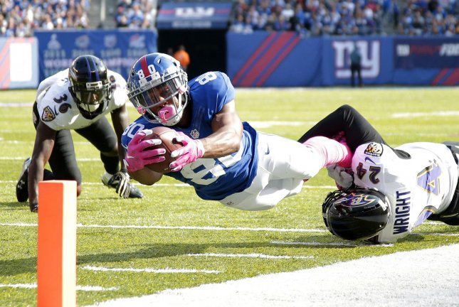 Former New York Giants receiver Victor Cruz dives for the end zone during a game against the Baltimore Ravens in 2016. Photo by John Angelillo/UPI
