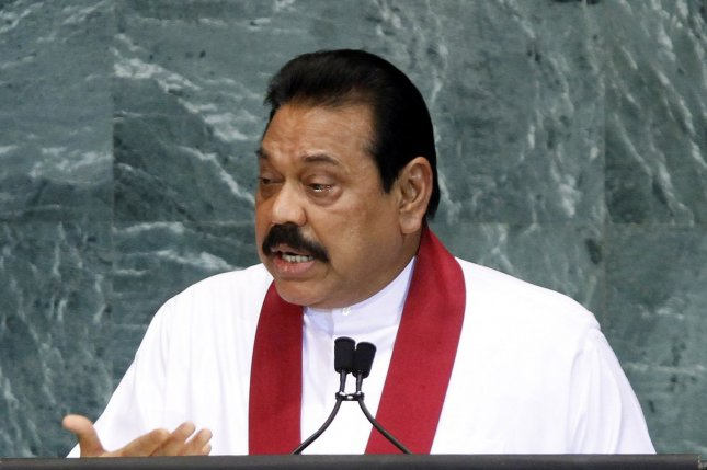Sri Lanka lawmakers will vote between Mahinda Rajapaksa, pictured, and Ranil Wickremesinghe for the post of prime minister on Monday. File Photo by John Angelillo/UPI