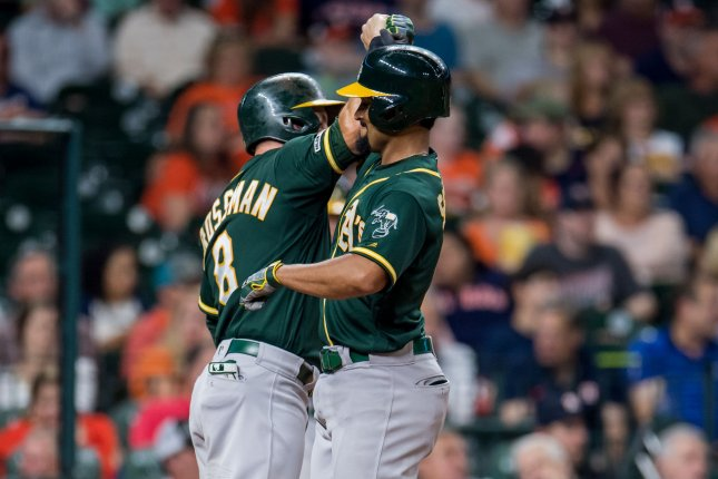 Oakland Athletics left fielder Robbie Grossman (L) and shortstop Marcus Semien each recorded three hits in a blowout of the Houston Astros Tuesday in Houston. Photo by Trask Smith/UPI