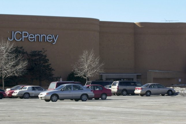 Cars are parked in front of the JCPenny store in the Chicago suburb of Skokie, Ill. in 2001. JC Penney said Thursday it will close 154 stores as part of its bankruptcy. Photo by Tannen Maury UPI