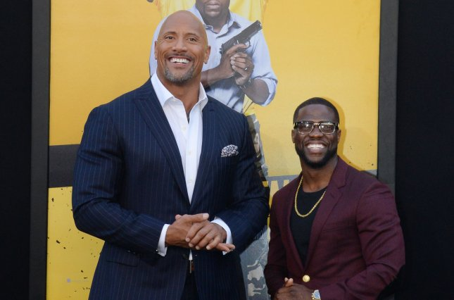 Dwayne Johnson (L) has announced the voice cast for DC League of Super-Pets, which includes Kevin Hart. Keanu Reeves, Kate McKinnon, John Krasinski and Diego Luna are also voicing characters. File Photo by Jim Ruymen/UPI