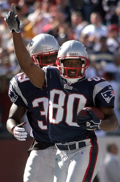 New England Patriots wide receiver Troy Brown, shown after scoring a touchdown in a game in 2006, on Thursday announced his retirement from professional football. (UPI Photo/Katie McMahon)
