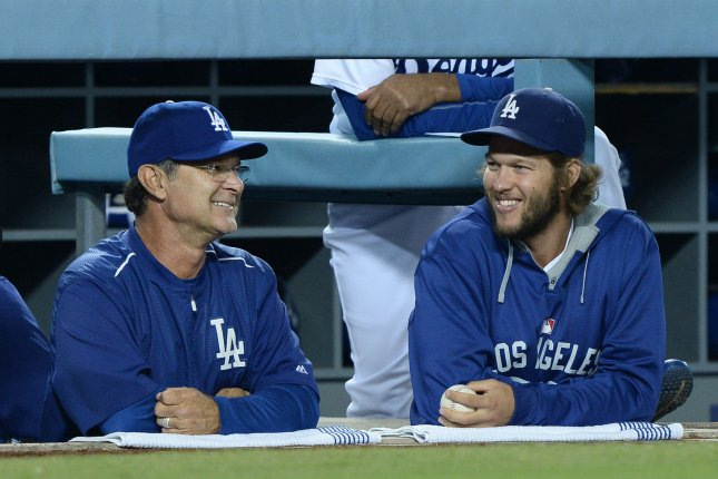 Los Angeles Dodgers' manager Don Mattingly (L) and pitcher Clayton Kershaw. Photo by Jim Ruymen/UPI