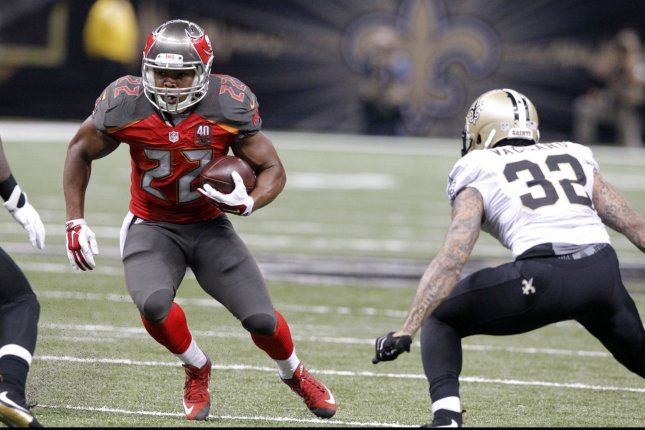 Tampa Bay Buccaneers running back Doug Martin (22) picks up short yardage against New Orleans Saints strong safety Kenny Vaccaro (32) during the third quarter at the Mercedes-Benz Superdome in New Orleans September 20, 2015. Photo by AJ Sisco/UPI