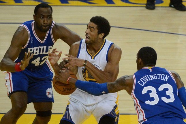 Golden State Warriors' James Michael McAdoo (C) has the ball stripped by Philadelphia 76ers' Robert Covington (33) as 76ers' Elton Brand looks on in the first half at Oracle Arena in Oakland, California on March 27, 2016. The Warriors defeated the 76ers 117-105. Photo by Terry Schmitt/UPI