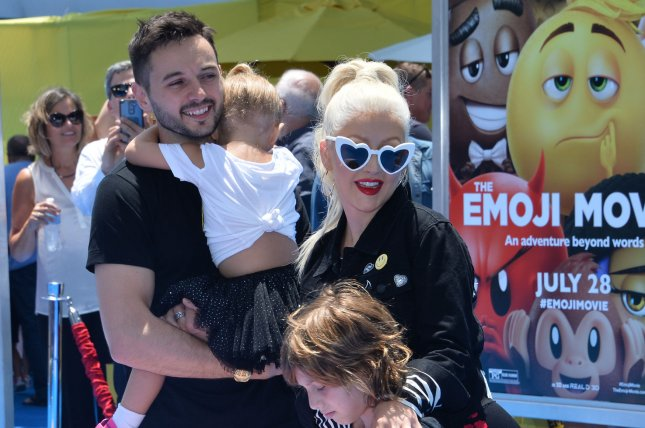 Christina Aguilera (R), pictured with Matthew Rutler and her kids, said Gwen Stefani's romance with Blake Shelton had nothing to do with her departure from The Voice. File Photo by Jim Ruymen/UPI
