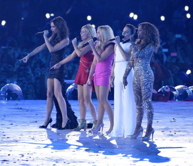 The Spice Girls perform during the closing ceremony for the London 2012 Summer Olympics on August 12, 2012, in London. The band's original double decker bus has been turned into an Airbnb rental. File Photo by Brian Kersey/UPI
