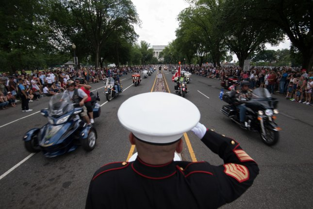 Retired USMC SSGT Tim Chambers salutes as motorcyclist pass during Rolling Thunder, the annual Memorial Day weekend motorcycle rally for veterans, prisoners of war and service members that draws hundreds of thousands of participants, in Washington, D.C. Photo by Kevin Dietsch/UPI