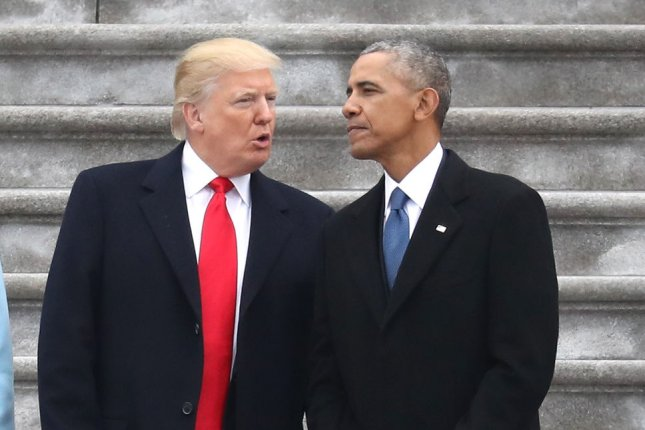 President Donald Trump and former president Barack Obama chat at the U.S. Capitol in Washington, D.C., on Jan. 20, 2017. Pool file photo by Rob Carr/UPI