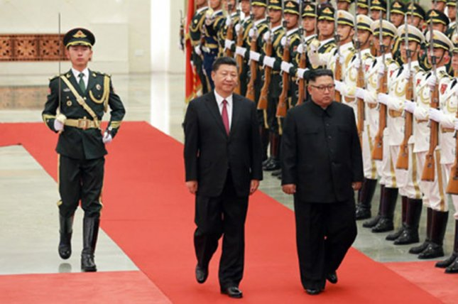 Chinese leader Xi Jinping (C) met more times with North Korea's Kim Jong Un (R) than any other world leader and influenced Kim's key decisions, a U.S. analyst said Friday. File Photo by KCNA/UPI