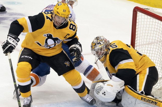 Pittsburgh Penguins center Sidney Crosby (L), who underwent wrist surgery this off-season, said he hopes to return in a week or two. File Photo by Archie Carpenter/UPI