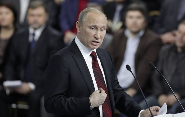 Russian Prime Minister and presidential candidate Vladimir Putin speaks during a meeting with his supporters from All Russian People's Front party in Moscow on February 29, 2012. The Russian presidential election is Sunday, March 4th. UPI/Yuri Gripas