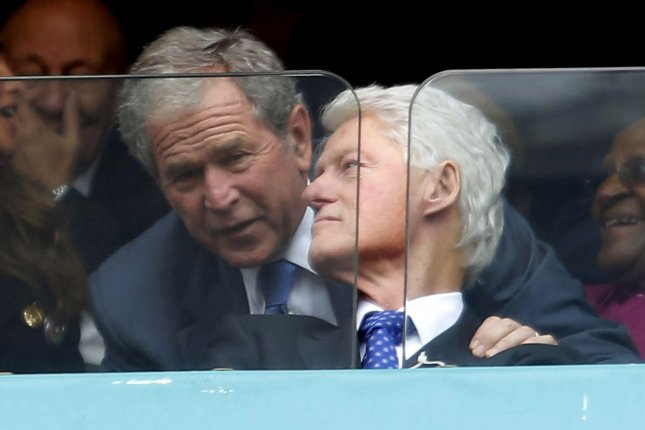 Former United States Presidents George Bush and Bill Clinton (R) are seen at the memorial service for former South African President and anti-apartheid leader Nelson Mandela at FNB Stadium in Johannesburg, South Africa, on December 10, 2013. UPI/Jemal Countess