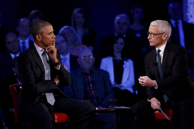 U.S. President Barack Obama participates in a live town hall event with CNN's Anderson Cooper on reducing gun violence in America at George Mason University in Fairfax, Virginia on January 7, 2016. Pool Photo by Aude Guerrucci/UPI