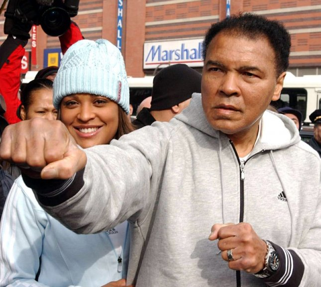 Boxing great Muhammad Ali died at the age of 74 in Phoenix, Ariz., on Saturday. He is shown here with his daughter Laila Ali in Harlem on Feb. 5, 2004. File photo by Ezio Petersen/UPI
