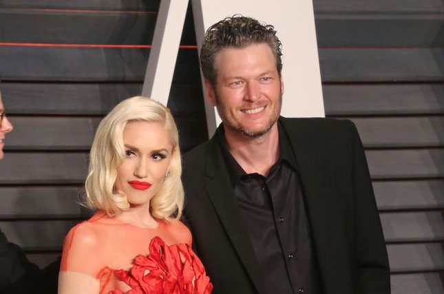 Gwen Stefani and Blake Shelton attend the 2016 Vanity Fair Oscar Party at the Wallis Annenberg Center for the Performing Arts in Beverly Hills on February 28, 2016. Stefani talks about her ever-changing music career and the ups and downs of her love life in the August issue of Harper's Bazaar. File Photo by David Silpa/UPI