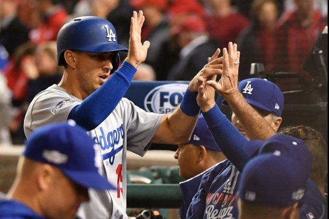 Los Angeles Dodgers catcher Austin Barnes high fives teammates. File photo by Kevin Dietsch/UPI