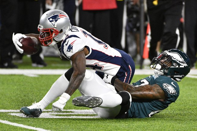 32512185 Former New England Patriots wide receiver Brandin Cooks (L) is tackled by  Philadelphia Eagles strong safety Malcolm Jenkins (R) during the first half  of ...