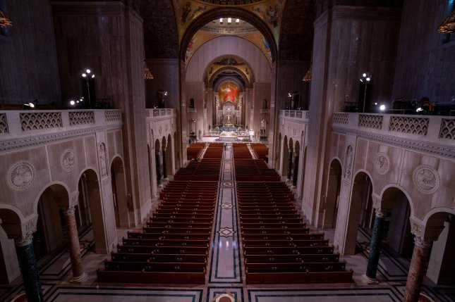 The Washington Archdiocese sued the city of Washington, D.C., over mandatory 50-person caps on religious services ahead of the Christmas holidays. Catholics traditionally celebrate mass in large churches like the Basilica of the National Shrine of the Immaculate Conception. File Photo by Kevin Dietsch/UPI