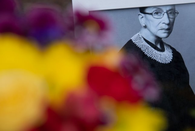 A picture of the late Supreme Court Justice Ruth Bader Ginsburg is places near the Supreme Court as mourners pay their respects as she lies in repose, in Washington, DC on Thursday, September 24, 2020. Ginsburg died last week at the age of 87 from pancreatic cancer. Photo by Kevin Dietsch/UPI..