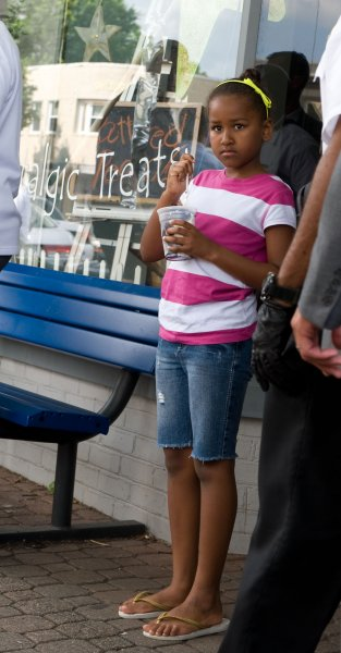Sasha Obama enjoys her cup of frozen custard during and outing with her father U.S. President Barack Obama and sister Malia at the Dairy Godmother frozen custard shop in the Del Ray section of Alexandria, Virginia on June 20, 2009. (UPI Photo/John Harrington/Pool)