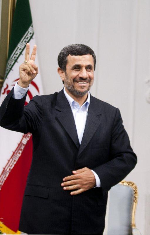 Iranian President Mahmoud Ahmadinejad makes a peace sign to the media before his official meeting with Masoud Barzani the head of the autonomous Kurdish region in Iraq, in presidential palace in Tehran,Iran on Oct 30,2011. UPI/Maryam Rahmanian