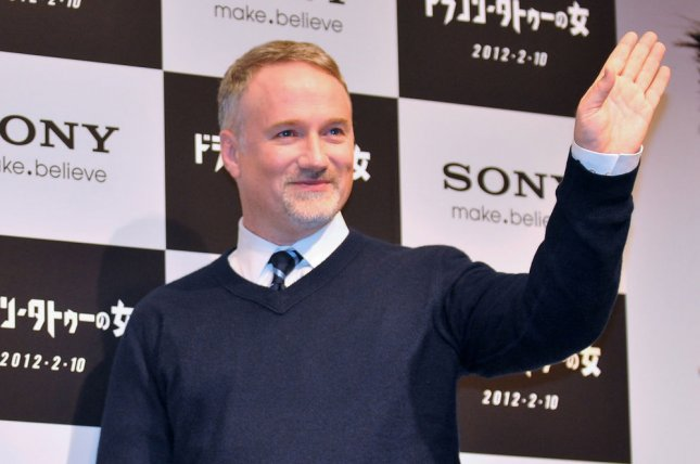 Actress Rooney Mara(L) and director David Fincher attend the press conference for the film The girl with the dragon tattoo in Tokyo, Japan, on January 31, 2012. This film will open on February 10 in Japan. UPI/Keizo Mori