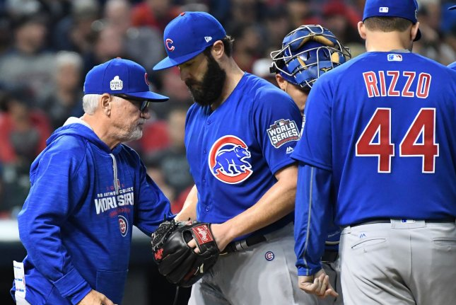 Chicago Cubs manager Joe Maddon (L) relieves starter Jake Arrieta in the sixth inning against the Cleveland Indians in game 6 of the World Series at Progressive Field in Cleveland, Ohio on November 1, 2016. Cleveland holds a 3-2 series lead over Chicago. Photo by Pat Benic/UPI