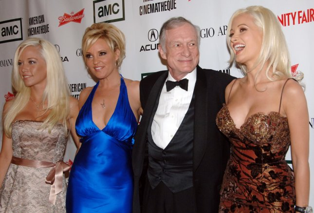 Playboy magazine founder Hugh Hefner and his three live-in girlfriends (L-R) Kendra Wilkinson, Bridget Marquardt and Holly Madison arrive at the American Cinematheque annual benefit gala in Beverly Hills on October 13, 2006. A docu-series about Hefner is to premiere on Amazon on April 7. File Photo by Jim Ruymen/UPI