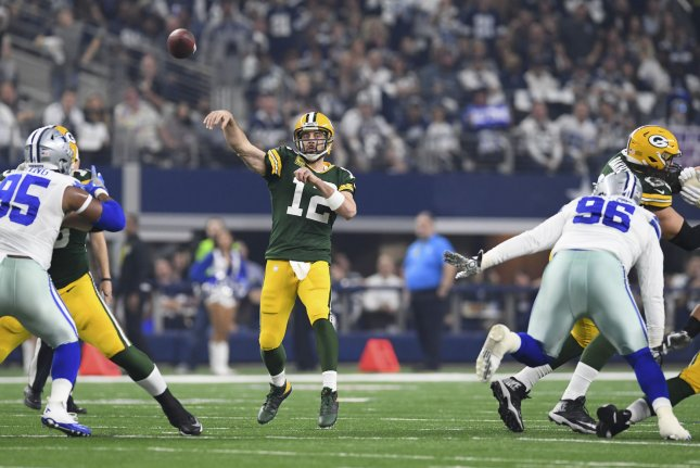 Green Bay Packers quarterback Aaron Rodgers (12) throws a touchdown pass against the Dallas Cowboys in the NFC divisional playoff game at AT&T Stadium in Arlington, Texas on January 15, 2017. File photo by Shane Roper/UPI