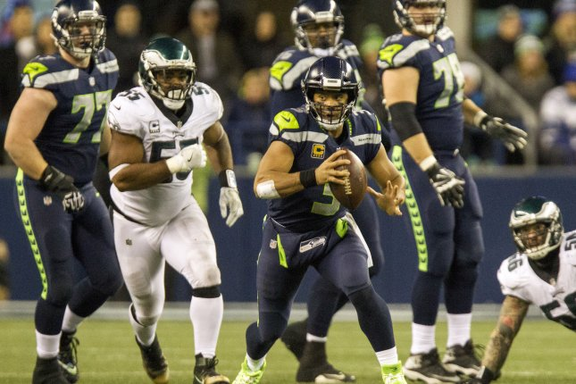 Seattle Seahawks quarterback Russell Wilson (3) scrambles against the Philadelphia Eagles during the second quarter on December 3 at CenturyLink Field in Seattle, Wash. Photo by Jim Bryant/UPI