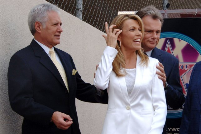 Left to right, Alex Trebek, Vanna White and Pat Sajak will soon return to the studio for new episodes of their game shows. File Photo by Jim Ruymen/UPI.