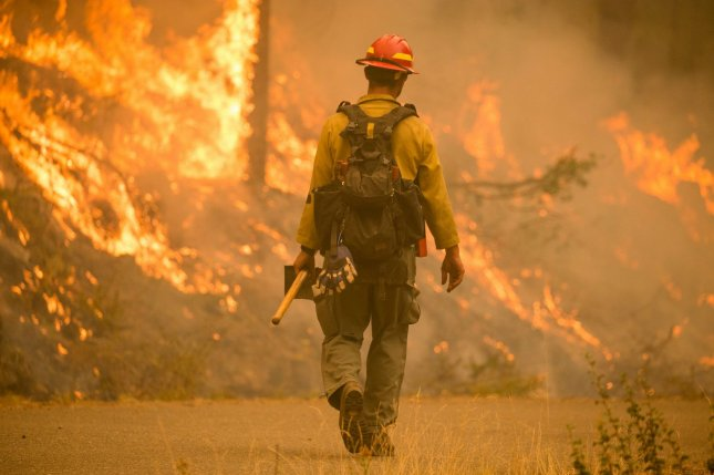Oregon Gov. Kate Brown, Washington Gov. Jay Inslee and Los Angeles Mayor Eric Garcetti declared Sunday that climate change has contributed to the wildfires that have burned 4.6 million acres in the western United States. Photo by U.S. Forest Service - Pacific Northwest Region/UPI