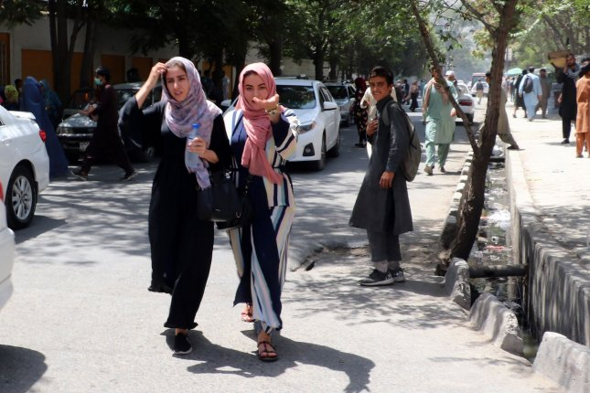 People rush to their homes after Taliban entered Kabul, Afghanistan, on Sunday. Photo by Bashir Darwish/ UPI