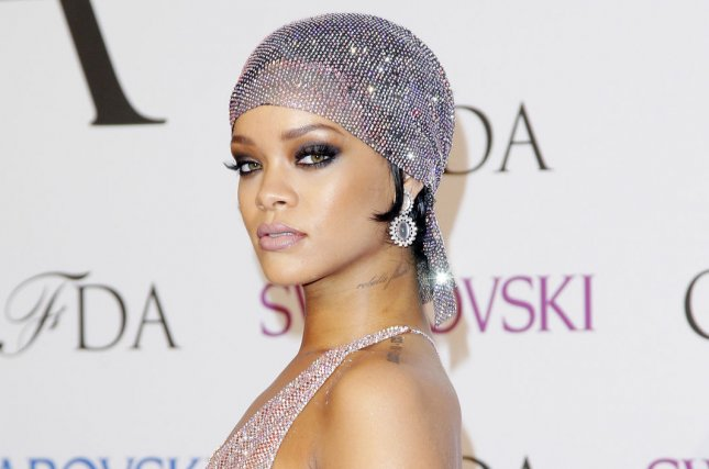 Rihanna counters TLC\'s criticism of her sheer CFDA gown with topless ...