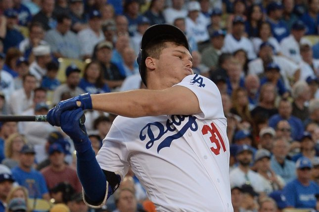 Los Angeles Dodgers' Joc Pederson nearly loses his helmet on a swing. File photo by Jim Ruymen/UPI