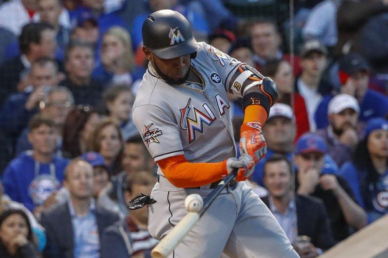 Miami Marlins' Marcell Ozuna hits the ball. File photo by Kamil Krzaczynski/UPI