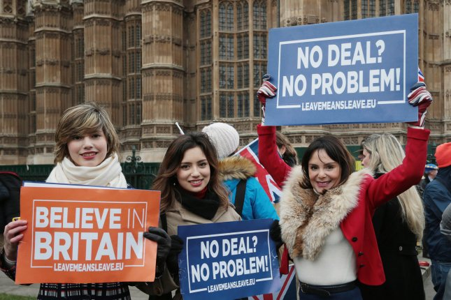 Protesters campaign outside Britain's Houses of Parliament before a vote in January, in which lawmakers rejected the proposed deal to leave the EU. Photo by Hugo Philpott/UPI