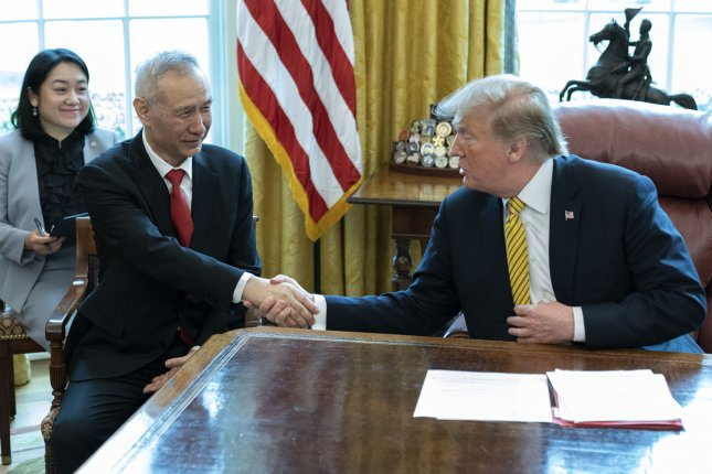 China's Vice Premier Liu He shakes hands with President Donald Trump. Trump announced Wednesday the U.S. willdelay a hike on tariffs against China. Photo by Chris Kleponis/UPI
