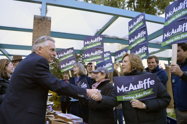 Virginia Democratic gubernatorial candidate Terry McAuliffe shakes hands with supporters after voting at the Spring Hill Elementary School, in McLean, Virginia, November 5, 2013. McAuliffe is running against former Virginia Attorney General Republican Ken Cuccinelli. UPI/Mike Theiler