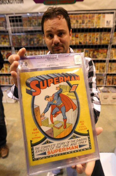 Jay Rodriquez of Bedrock City Comic Company of Houston, displays the very rare first Superman comicbook that he had for sale during the Comic Con convention in St. Louis on March 23, 2013. UPI/Bill Greenblatt