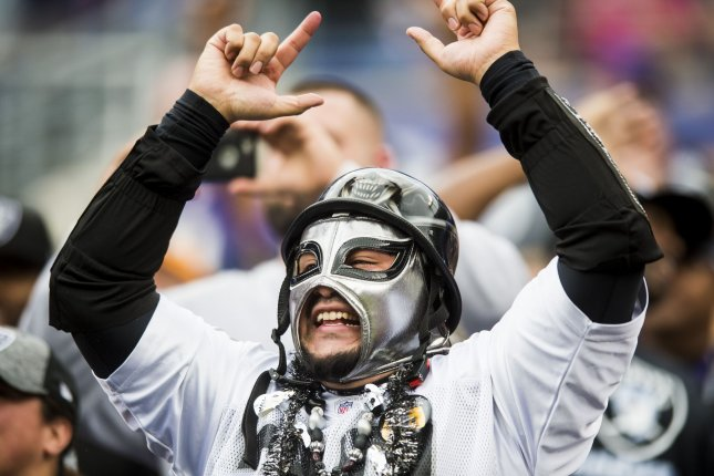An Oakland Raiders fan shows his support during second quarter action at M&T Bank Stadium in Baltimore, Maryland on October 2, 2016. Photo by Pete Marovich/UPI