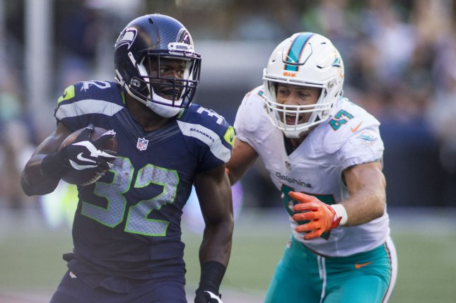 Seattle Seahawks running back Christine Michael (32) runs away from Miami Dolphins linebacker Kiko Alonso (47) for a 12 yard gain in the third quarter at CenturyLink Field in Seattle, Washington on September11, 2016. Seahawks came from behind to beat the Dolphins 12-10. Photo by Jim Bryant/UPI