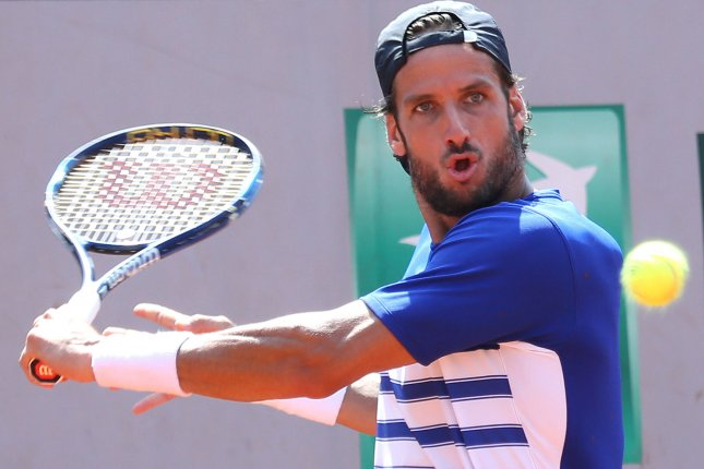 Feliciano Lopez of Spain hits a shot during his French Open men's second round match against David Ferrer of Spain at Roland Garros in Paris on June 1, 2017. File photo by David Silpa/UPI